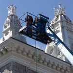 workmen powerwash ornate towers